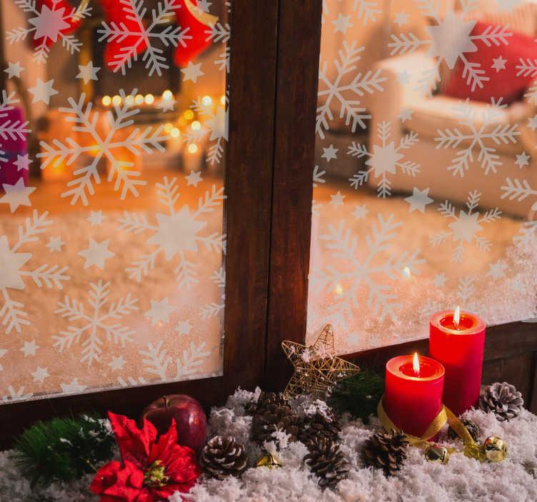 TenStickers. Sticker flocons de neige vitrine. Découvrez notre sticker représentant des décorations de noël spécialement réalisé pour les vitrines. Idéal pour décorer votre intérieur.