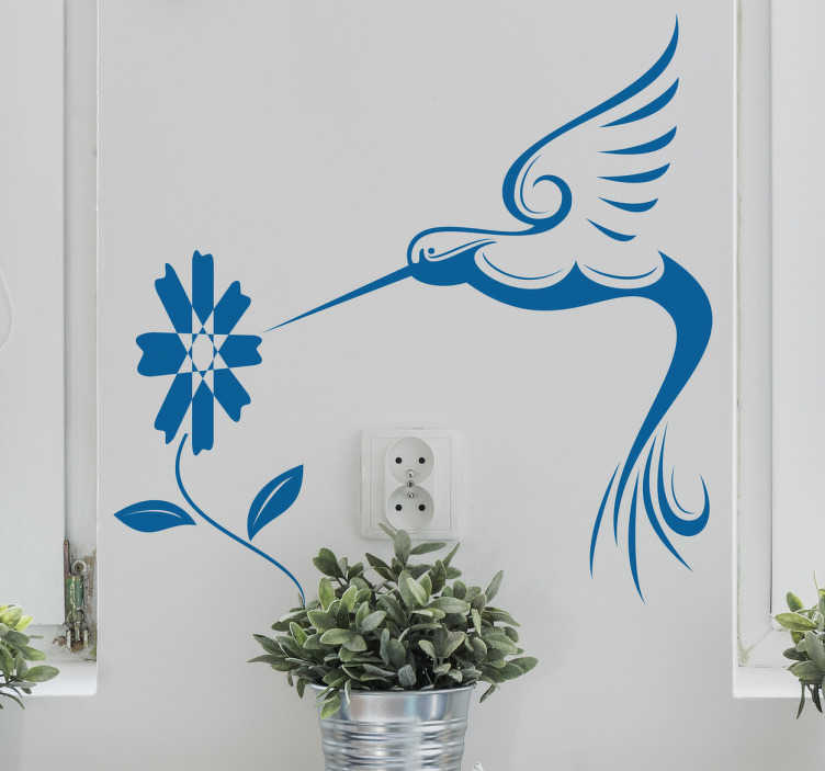 TenVinilo. Vinilo decorativo ornamental colibrí. Vinilos ornamentales con el dibujo de un ave exótico volando sobre una flor.