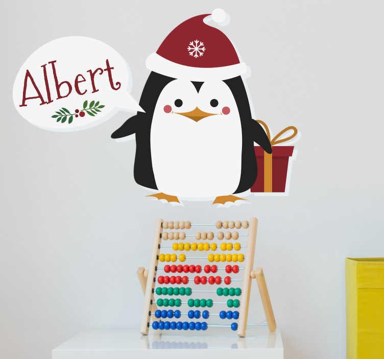 TenVinilo. Vinilo navidad pingüino personalizable. Tierna pegatina pingüino que lleva el nombre de tu pequeño junto a sus regalos de navidad