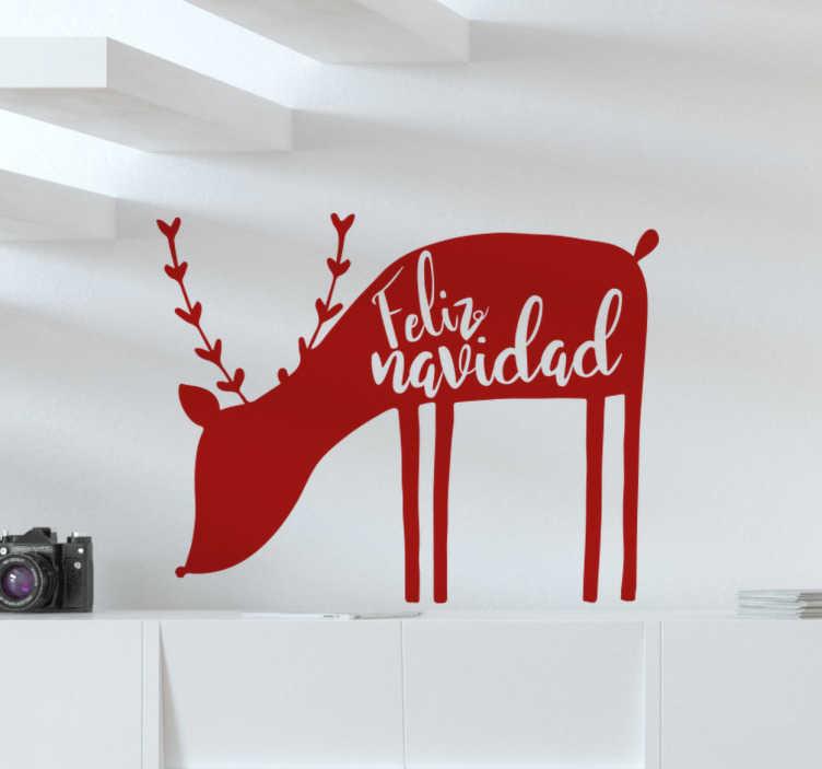 """TenVinilo. Vinilo Navidad Reno. Vinilo reno que muestra la silueta ilustrativa de un pequeño reno pastando y que contiene la frase """"feliz navidad""""."""