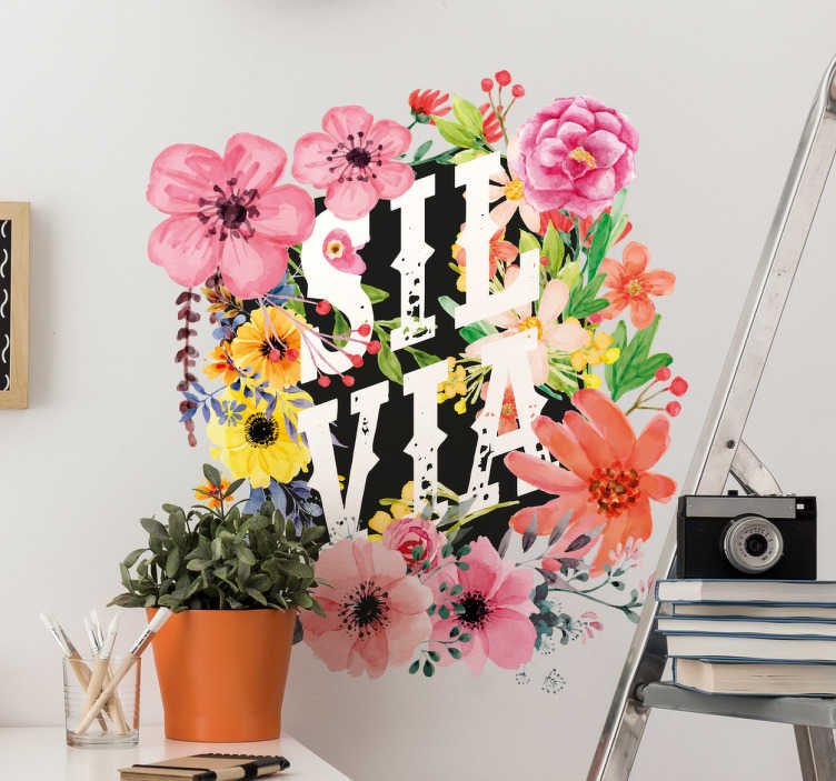TenVinilo. Vinilo personalizable flores. Pegatinas personalizadas ornamentales con el nombre que desees introducir sobre un colorido marco floral.