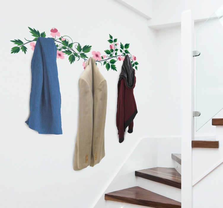 TenVinilo. Vinilo decorativo perchero floral. Vinilo perchero formado por una rama llena de hojas y flores rosadas en la que podrás poner los colgadores.