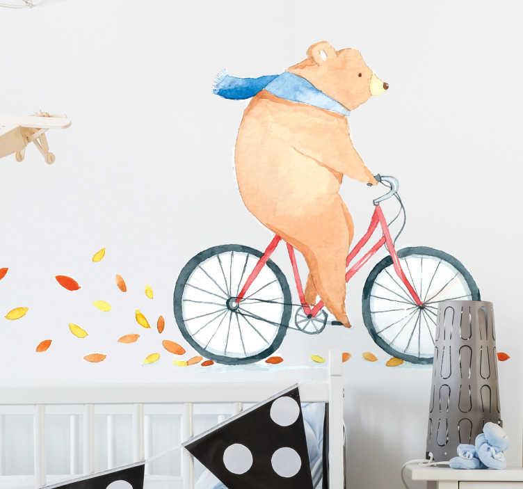 TenVinilo. Vinilo infantil oso bicicleta otoño. Vinilo mural con el dibujo de un oso corriendo en bici y levantando hojas otoñales a su paso.