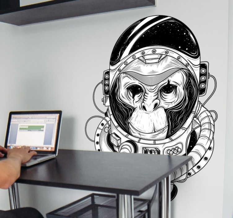 TenVinilo. Vinilo decorativo mono astronauta. Decora tu casa con vinilos murales modernos y arriesgados, adaptados a tus gustos estéticos y tu afición por la astronomía y los viajes espaciales.