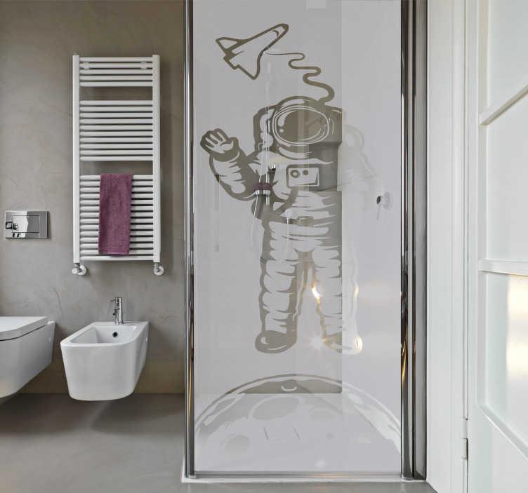 TenVinilo. Vinilo mampara ducha astronauta. Vinilos para baño con el dibujo de un explorador espacial dando un paseo sobre la Luna, ideal para la mampara de tu ducha.