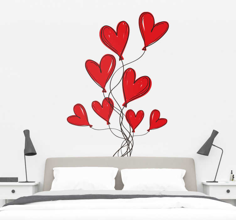 TenVinilo. Vinilos amor cabezal para cama. Original cabecero adhesivo formado por un conjunto de globos con forma de corazón que está pensado para ser aplicado sobre la pared.