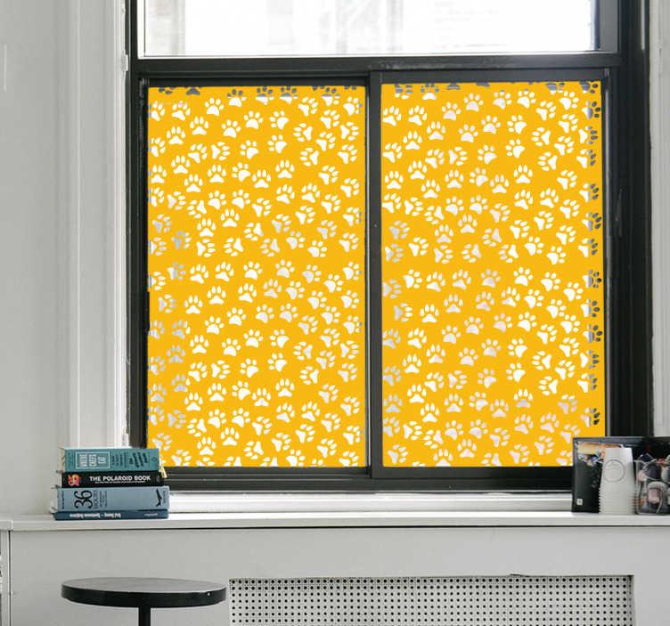 TenVinilo. Vinilo ventana huellas animales. Vinilos para cristales disponibles en el tamaño que requieras con un patrón de huellas de mascota, disponible en color y translúcido.