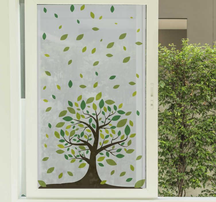 TenVinilo. Vinilo para ventana árbol. Vinilos para cristales con el dibujo de un árbol en la base y hojas verdes en la parte superior para decorar las ventanas de cualquier estancia.