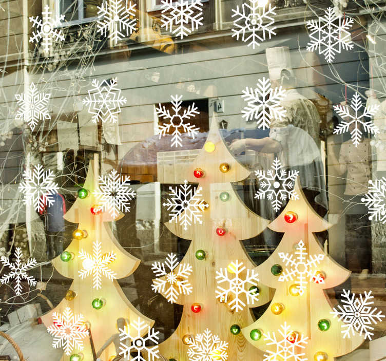 TenVinilo. Vinilos para escaparate de tienda nieve. Stickers para decorar los cristales de tu negocio estas navidades con diversos iconos de copos de nieve, perfecto para ambientar tu tienda.