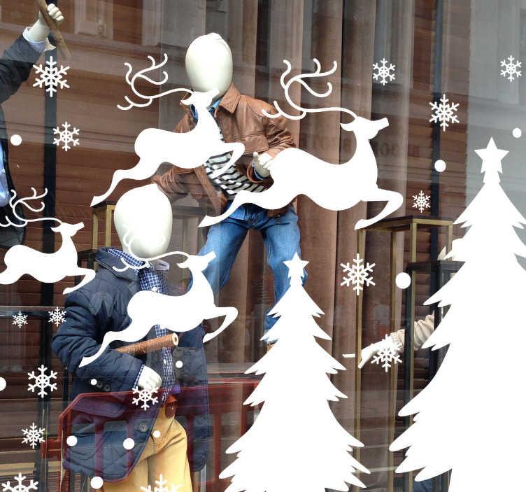 TenVinilo. Vinilo empresa vitrina invierno. Original vinilo para escaparate con temática navideña formado por una combinación de renos, abetos, copos de nieve y puntos en diferentes tamaños.