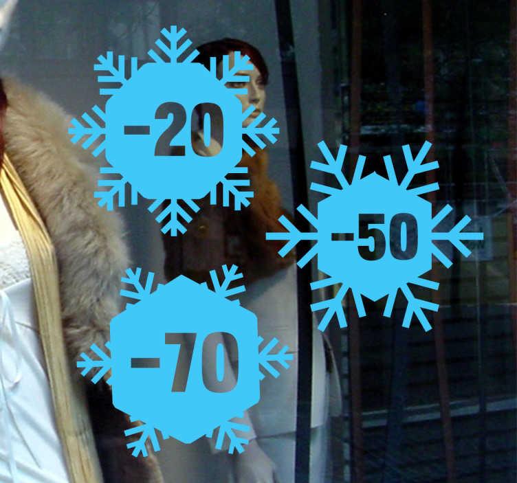 Tenstickers. Talviale ikkunatarra. Talviale ikkunatarra. Suloiset lumihiutalemaiset mainostarrat liikkeen näyteikkunaan, jotka osoittavat sesongin alennusprosentit.