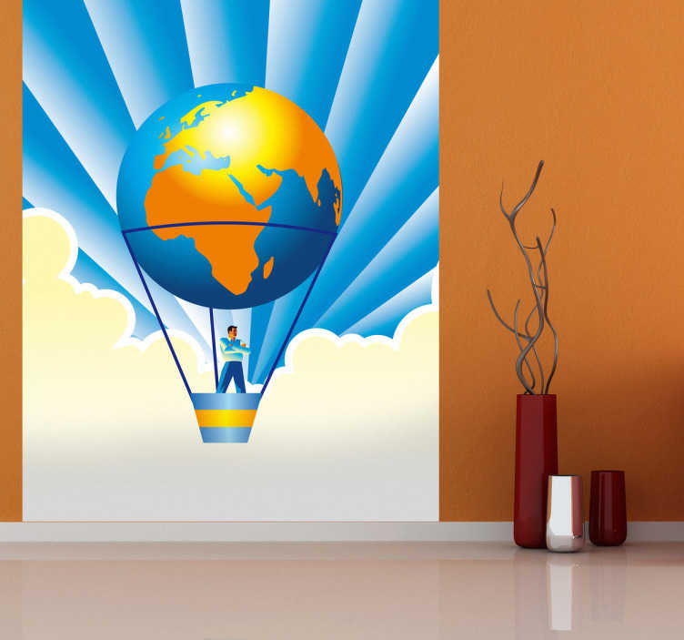 TenStickers. Naklejka światowy balon. Naklejka dekoracyjna przedstawiająca ilustrację  balona w postaci kuli ziemskiej, który podróżuje mężczyzna dumnie stojący i obserwujący mijany świat.