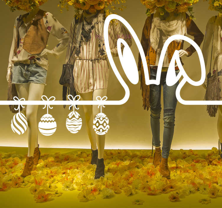TenVinilo. Vinilo para cristales escaparate pascua. Adhesivo para cristales de escaparates con el dibujo de las orejas del conejo de pascua junto con cuatro huevos decorados para esta fecha señalada.