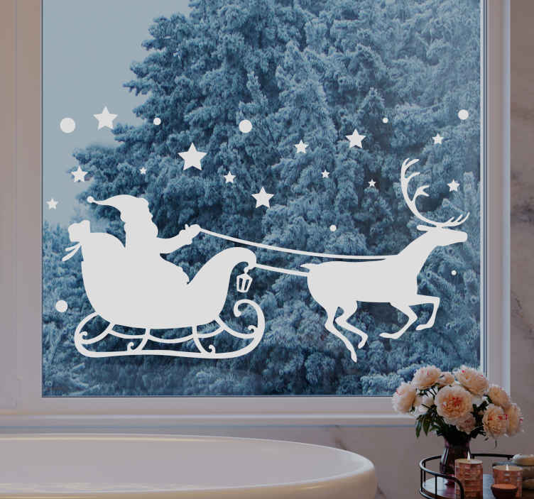 TenStickers. Santa flying over a town christmas wall sticker. As kids, we love to imagine Santa flying in his sleigh over your own town, well why not decorate your window with this christmas stickers!