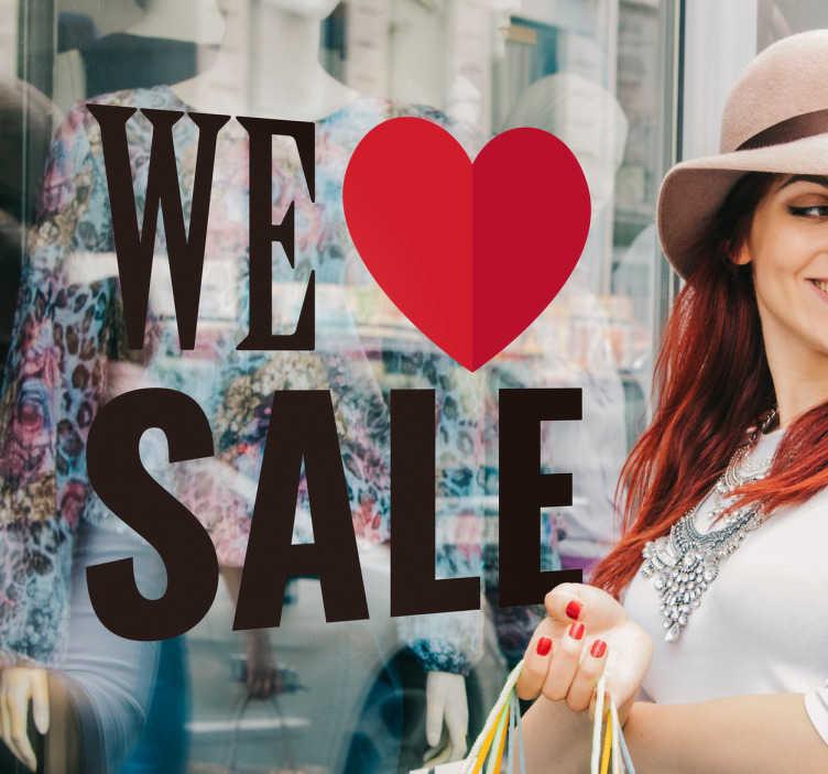 """TenStickers. Sticker vitrine we love sale. Un autocollant pour les professionnels, et surtout pour leurs vitrines lors de la période des soldes avec le texte """"we love sale""""."""