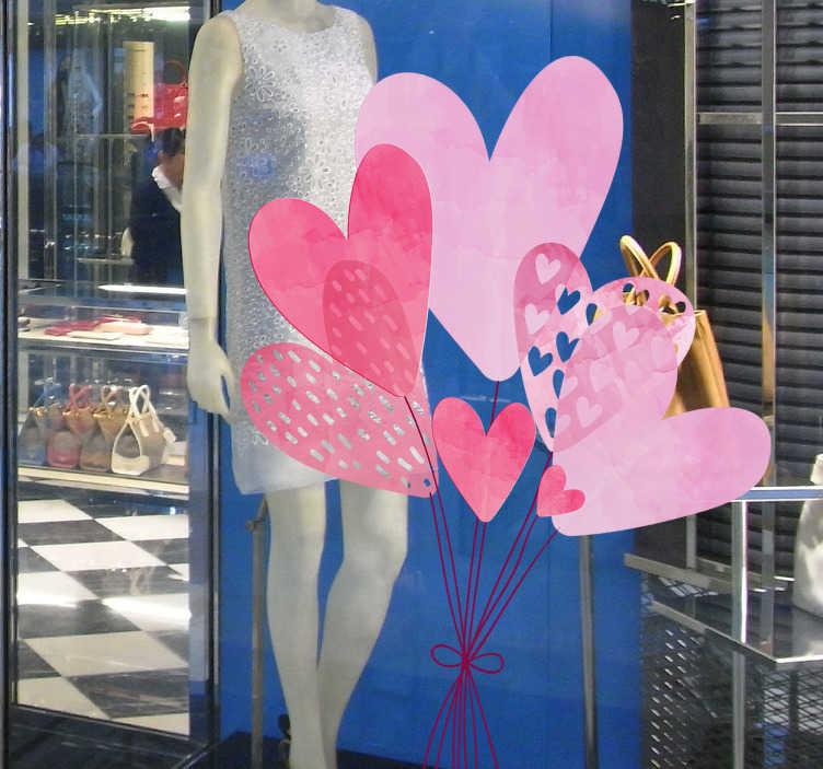 TenStickers. Naljepnice zidova na balonima srca. Valentinova na vinil naljepnici s dizajnom balonskih srca za ukrašavanje poslovnog prednjeg prozora. Dostupan je u bilo kojoj veličini.