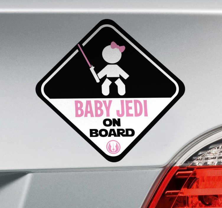 """TenStickers. Naklejka dziecko na pokładzie Baby Jedi on board. Naklejka na samochód """"dziecko w aucie"""" z zabawnym rysunkiem dziewczynki Jedi z różową kokardką i napisem """"Baby Jedi on board"""". Jeśli jesteś miłośnikiem Gwiezdnych Wojen, ta naklejka jest idealna dla Ciebie! Ceny już od 8,75 zł!"""