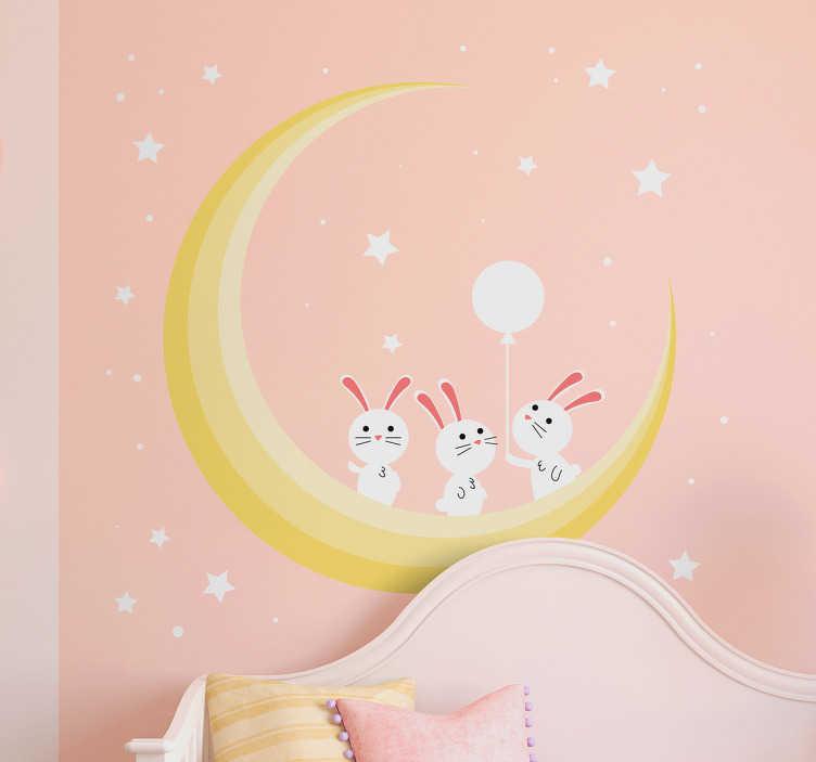 TenVinilo. Vinilo estrellas habitacion bebé. Decora paredes infantiles con un bonito dibujo de tres conejos jugando sbre la luna y fondo estrellado.