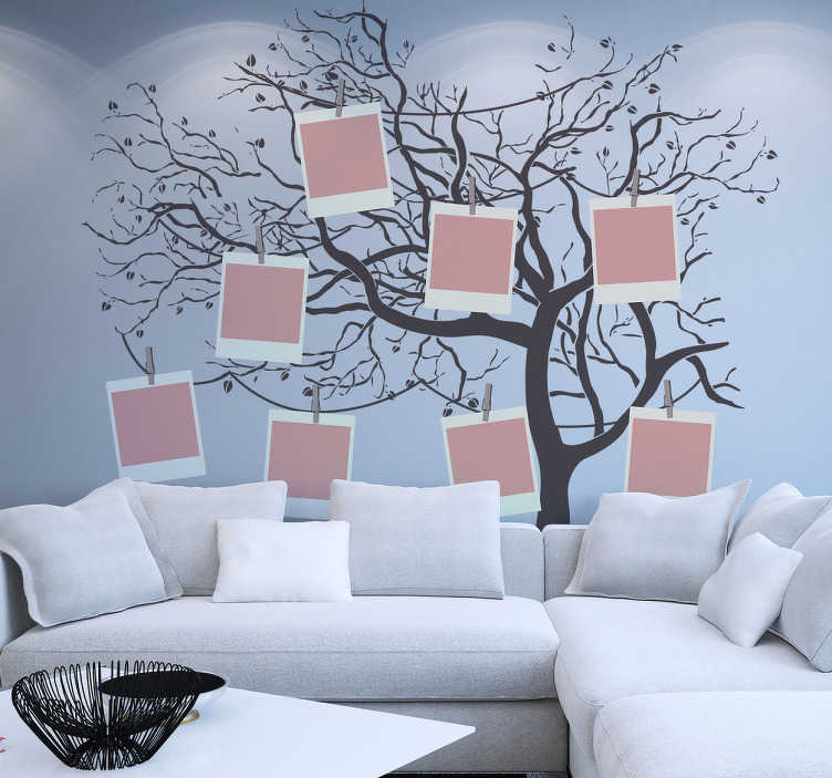 TenVinilo. Vinilo árbol genealógico. Mural pared en vinilo decorativo con un espectacular diseño del perfil de un árbol otoñal sobre el cual cuelgan marcos para fotografías.