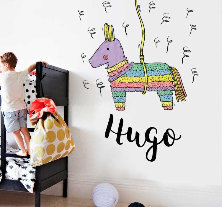 TenVinilo. Vinil infantil piñata. Vinil para niños y niñas con el dibujo de una piñata con forma de burro y en la parte inferior un texto personalizable.