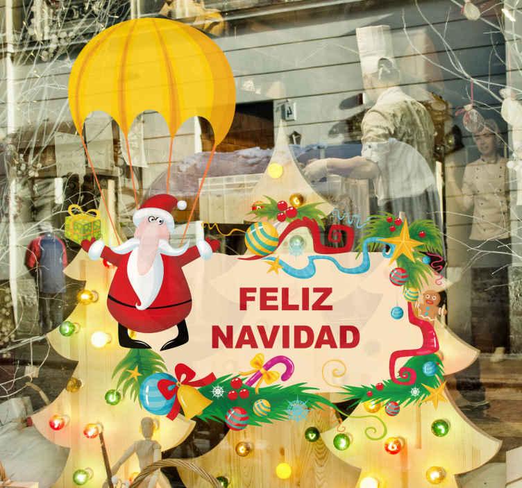 TenStickers. Sticker Père Noël en parachute. Stickers représentant le Père Noël sautant en parachute. Adhésif applicable aussi bien dans un salon ou sur une vitrine de magasin.