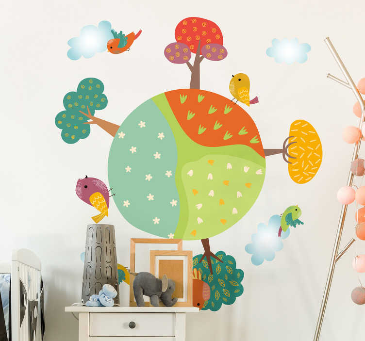 TenVinilo. Vinilo bebé primavera. Murales infantiles pared en vinilo para decoración con un lindo dibujo de un planeta lleno de vegetación y aves revoleteando a su alrededor.