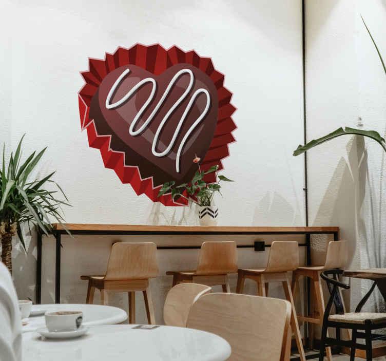 TenStickers. Naklejka dekoracyjna bombonierka. Naklejka dekoracyjna przedstawiająca pyszną czekoladkę w formie serca. Oryginalny pomysł na stworzenie walentynkowej atmosfery.