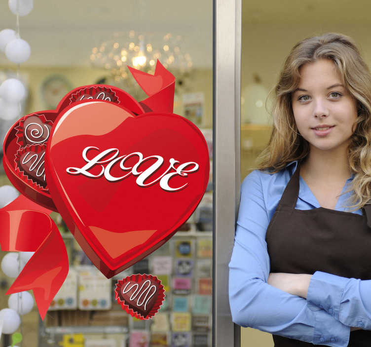TenStickers. Heart Shape Love Chocolate Box Sticker. An open heart shaped chocolate box filled with treats! Brilliant heart wall art decal to decorate your shop front window during Valentine's Day!