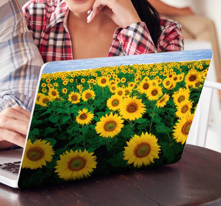 TenStickers. Laptop sticker zonnebloem. Vrolijk uw laptop nu makkelijk op met deze laptop sticker met zonnebloemen. Deze laptop sticker geeft u het blije gevoel van lekker weer.