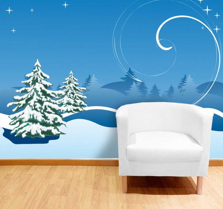 TenStickers. Naklejka dekoracyjna zima. Naklejka dekoracyjna w formie fototapety, która przedstawia bajkowo-zimowy krajobraz z ośnieżonymi choinkami.