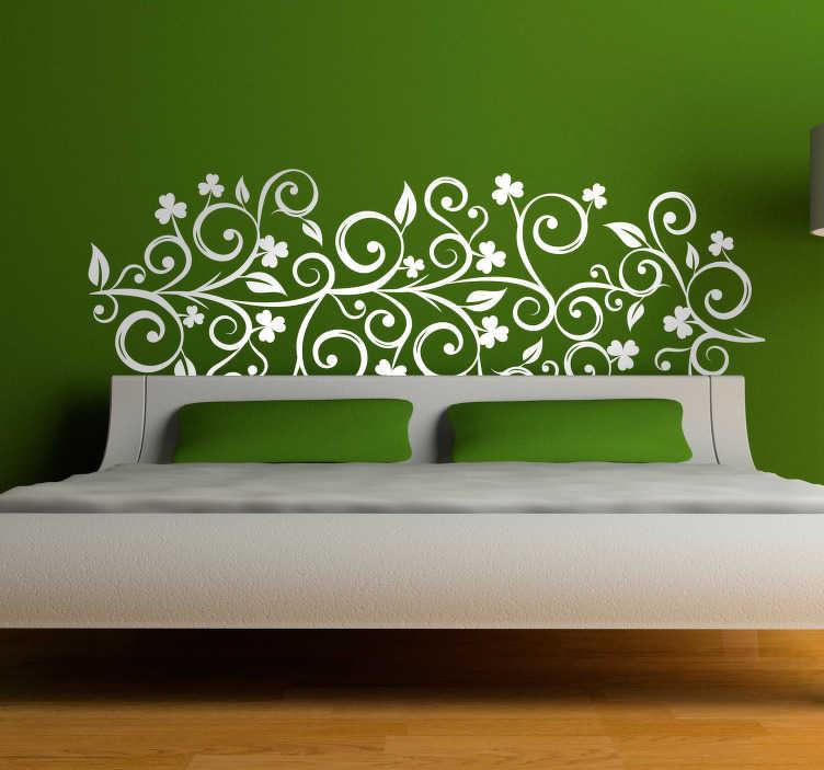 TenVinilo. Cabeceros para camas tréboles. Vinilos para cama sin cabecero con un dibujo ornamental floral de inspiración celta con el perfil de plantas y tréboles de tres hojas.