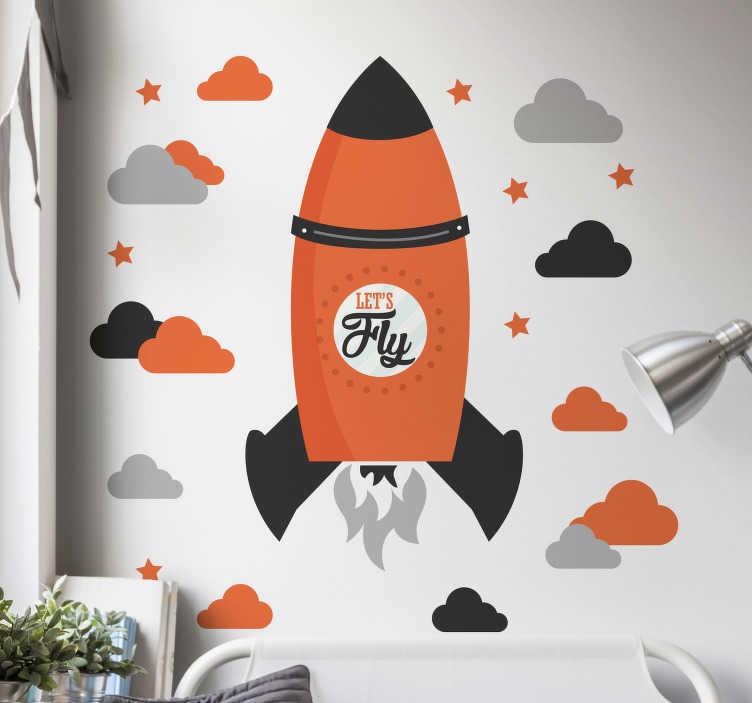 """TenVinilo. Vinilo infantil let's fly. Vinilos infantiles con el dibujo de un cohete sobrevolando un cielo con nubes y estrellas y el texto en inglés """"vamos a volar"""" ."""