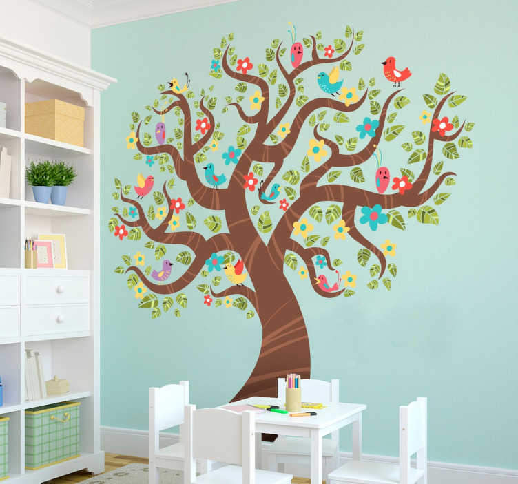 TenStickers. Naklejka wiosenne drzewo 1. Naklejka na ścianę, która z pewnością odświeży wygląd Twojego pokoju. Obrazek przedstawia drzewo z wiosennymi kwiatami.