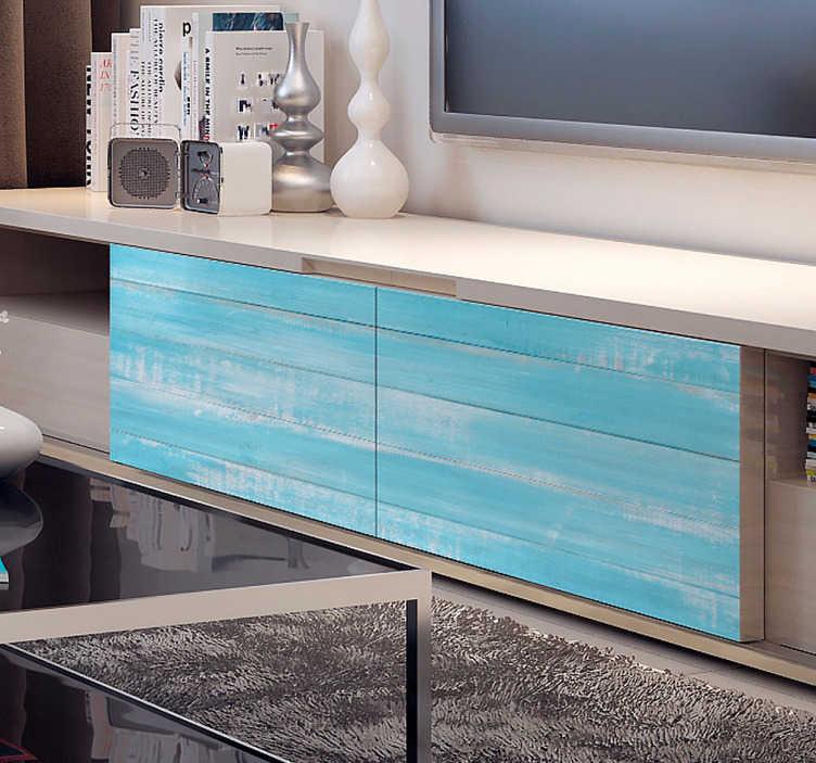 TenStickers. Sticker pour meuble effet bois. Sticker coloré donnant une texture bois à la surface où vous le posez. Sticker représentant des planches bleues aux couleurs légèrement passées, comme si la mer et le sable étant venu poncer le bois. Un sticker facile d'application qui viendra transformer vos meubles banals en un rien de temps!