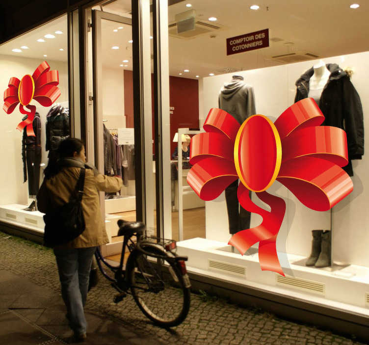 Tenstickers. Et julestrykkvindu klistremerke. Et veggmaleri som illustrerer en rød bue som ville være en perfekt dekorasjon for butikken din under julen! Sørg for at butikken din er enestående i juletiden!