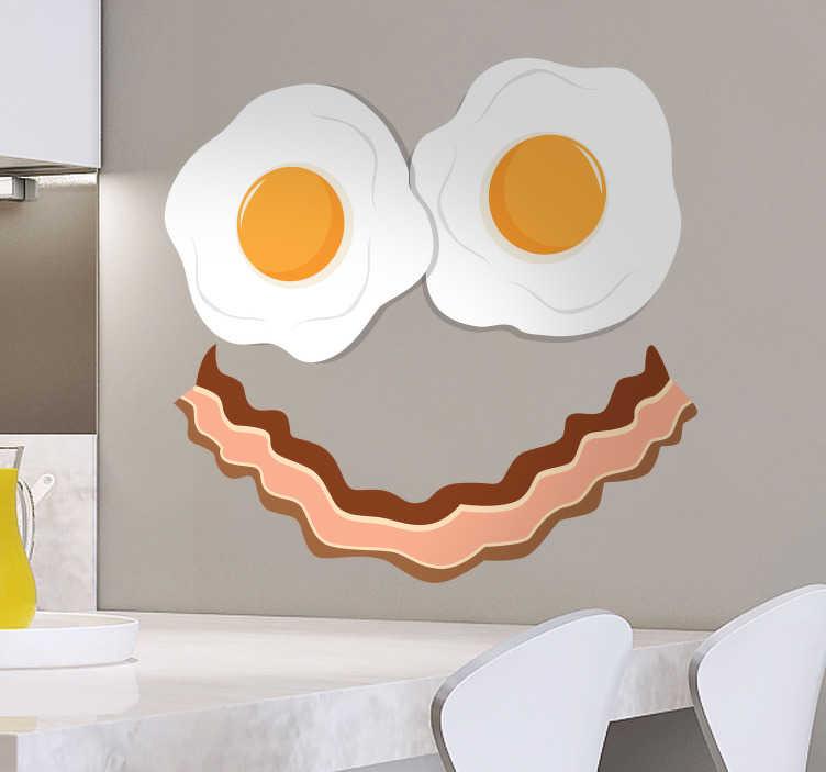 TenStickers. Wandtattoo Gesicht Speck und Ei. Wandtattoo Küche - Dekorieren Sie Ihre Küche mit einem lustigen Wandtattoo eines Gesichts, das aus zwei Spiegeleiern und einem Streifen Bacon besteht. Bringen Sie durch unseren witzigen Küchenaufkleber frischen Wind in Ihre Küche und bringen Sie Gäste zum Schmunzeln.