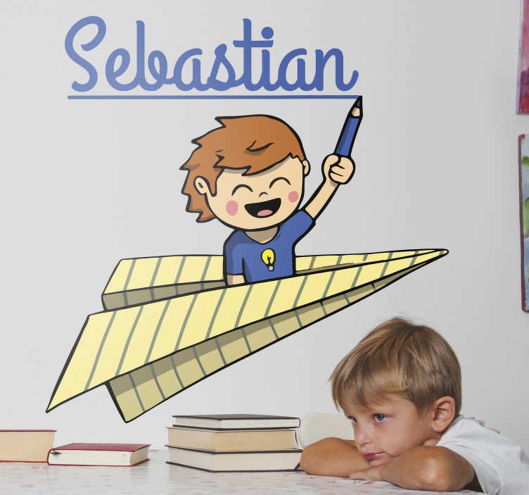 TenVinilo. Pegatina nombre personalizado estudiante. Pegatinas nombres originales y divertidas con el dibujo de un niño montado sobre un avión de papel con un lápiz en la mano dibujando su nombre.