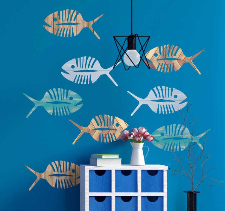 TenVinilo. Pegatinas peces marinos. Vinilos para pared con el dibujo de varios pescados en distintos colores y con textura de madera envejecida.
