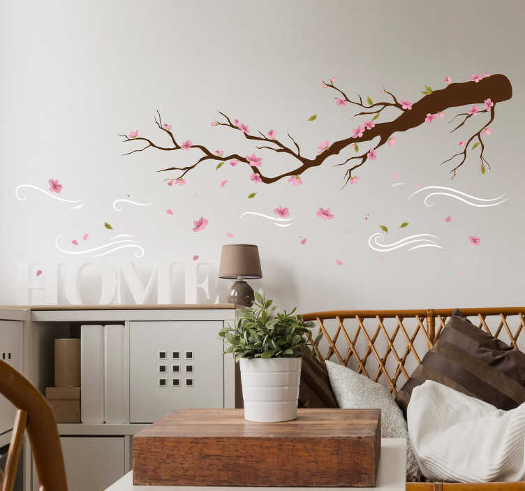 TenStickers. Muursticker boom Tak met roze bloemen in de wind. Creëer een vrolijke sfeer in huis door middel van deze muursticker van roze bloemen in de wind. Pas de afmetingen aan naar eigen wens.