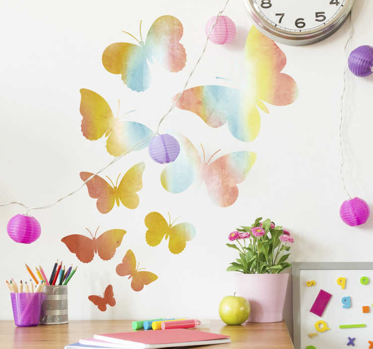 TenStickers. Rainbow Butterflies Wall Sticker. Bring the rainbow to you with this gorgeous wall decal! Ideal for adding a splash of colour to your home! Stickers from £1.99.