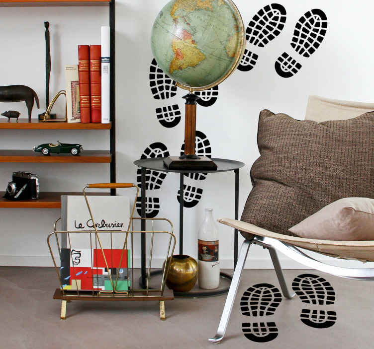TenStickers. Mensen muursticker voetafdrukken. Decoreer de muren in woning met deze originele sticker met meerdere voetafdrukken.. Verkrijgbaar in meerdere kleuren en maten. Voordelig personaliseren.