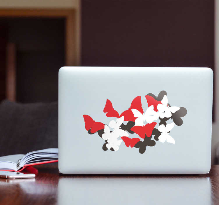 TenVinilo. Vinilo portátil Mariposas volando. Original pegatina adhesiva para portátil o tablet con el diseño de varias mariposas sobrepuestas en colores rojo, negro y blanco.