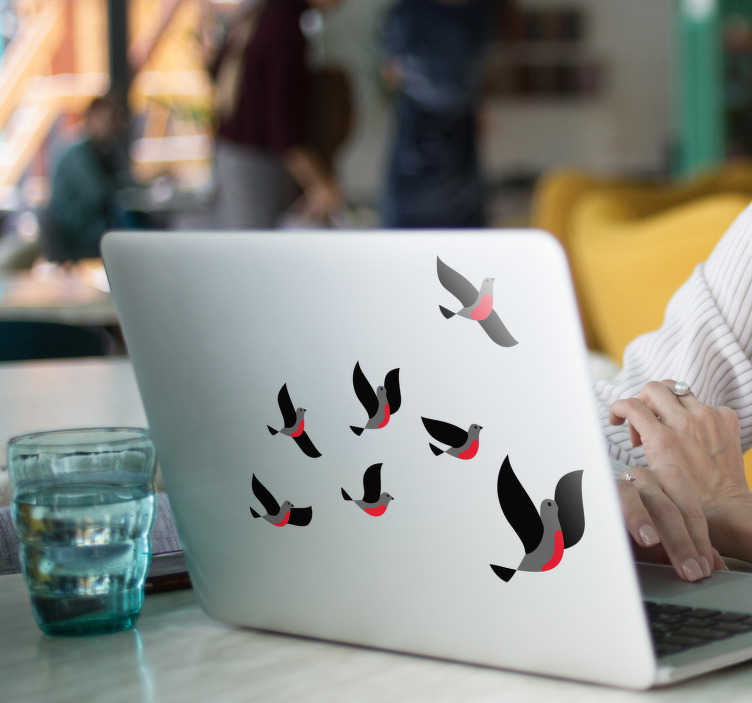 TenVinilo. Vinilo portátil Pájaros volando. Pegatina para portátil o tablet con el diseño de siete pájaros diferentes en tonos gris y rojo. Vinilos Personalizados a medida.