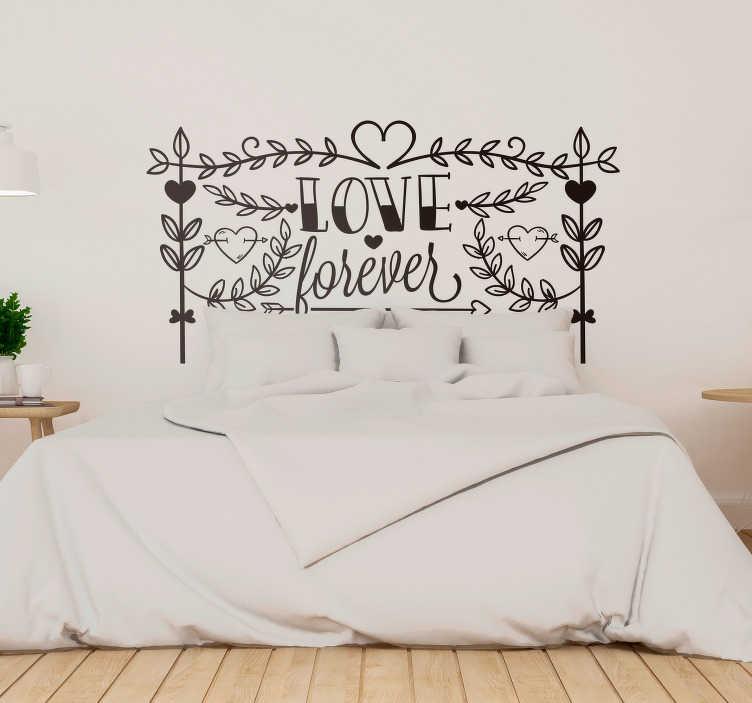 TenVinilo. Vinilo frase Amor forever. Vinilo adhesivo con un diseño floral y romántico que simula la estructura de un cabecero para habitación de matrimonio. Envío Express en 24/48h.