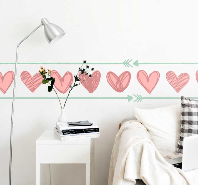 TenVinilo. Cenefa adhesiva Cenefa San Valentín. Original y tierna cenefa adhesiva en tonos pastel formada por un patrón de corazones y enmarcada por unas flechas. Descuentos para nuevos usuarios.