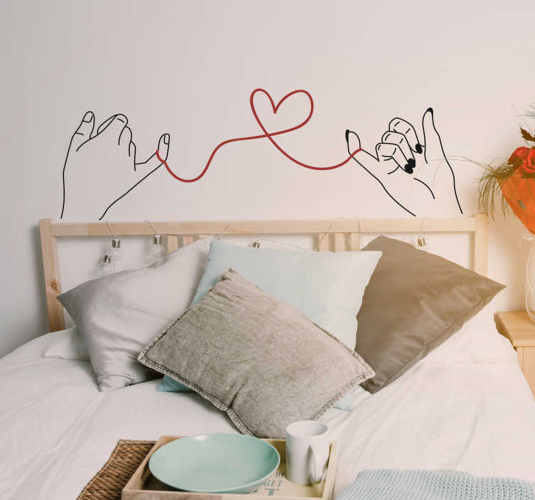 TenStickers. The red thread valentine´s day  wall decal. Saint valentine's day wall sticker made with two hands holding a thread heart tie. Easy to apply and available in any required size.