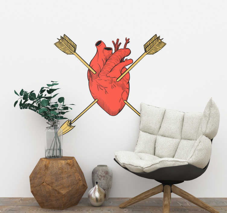 TenStickers. Naklejka z rysunkiem serce przebite strzałami. Naklejka z sercem przebitym strzałami. Wyjątkowy rysunek pokazujący organ ludzki zamiast symbolu miłości! Wyprzedaż się kończy, zamów taniej teraz!