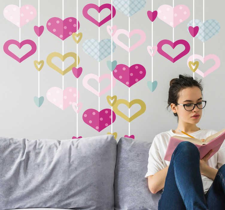 TenVinilo. Sticker de amor Guirnalda corazones. Original vinilo formado por varios corazones con diferentes estampados que simulan estar colgando de un hilo. Atención al Cliente Personalizada.