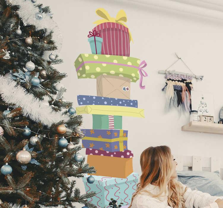 TenVinilo. Vinilo pared regalos apilados. Pegatina ideal para decorar tu hogar o el escaparate de tu tienda, formada por la ilustración de once regalos apilados. +50 Colores Disponibles.