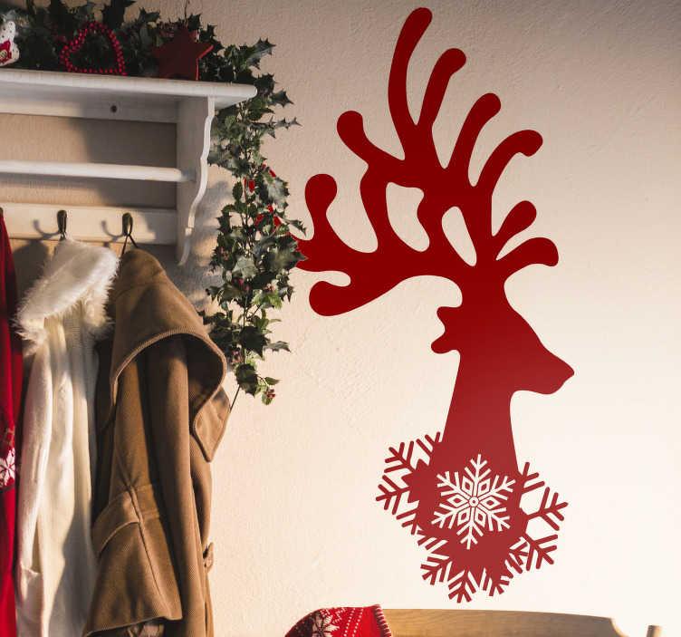 TenVinilo. Vinilo pared ciervo y copo de nieve. Original pegatina adhesiva monocolor con temática navideña formada por la ilustración de un reno y un copo. Vinilos Personalizados a medida.